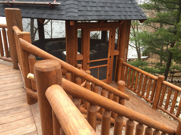 Log stair railing on the deck