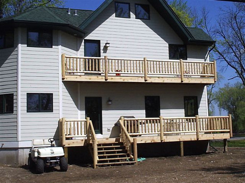 Log railing on deck and balcony